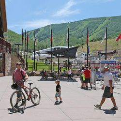 People line up at the payday lift at the base of the Park City Mountain Resort, Wednesday, July 2, 2014, in Park City.