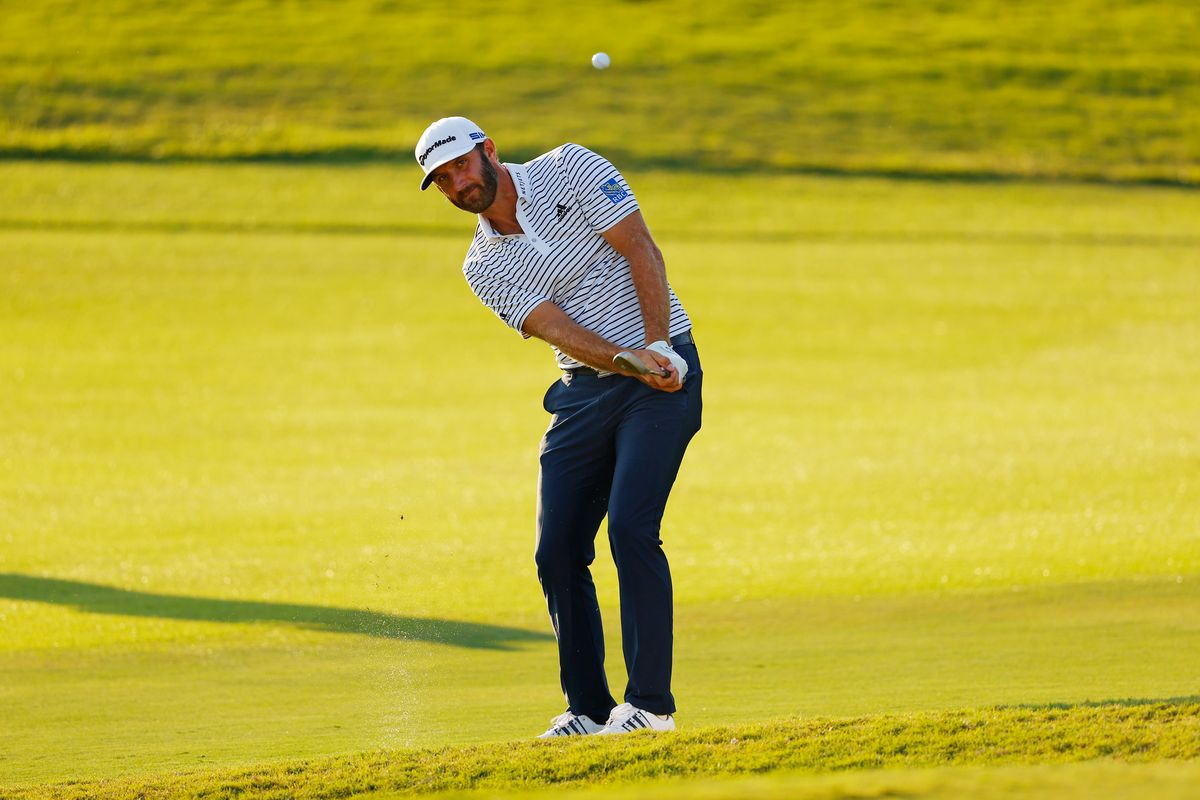 Dustin Johnson of the United States plays a shot on the 18th hole during the third round of the TOUR Championship at East Lake Golf Club on September 06, 2020 in Atlanta, Georgia.