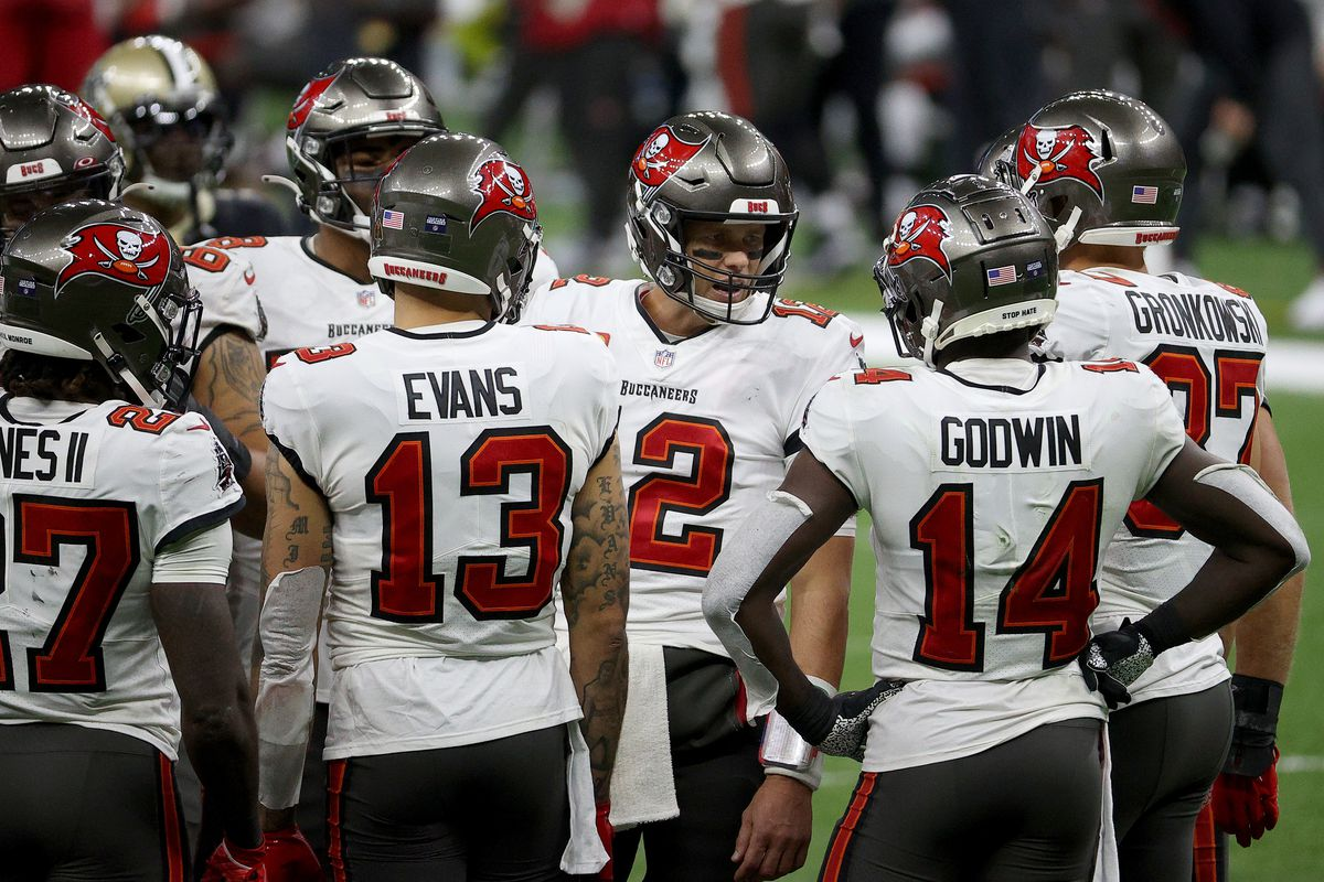 Tom Brady #12 of the Tampa Bay Buccaneers talks with his team in a huddle against the New Orleans Saints during the third quarter in the NFC Divisional Playoff game at Mercedes Benz Superdome on January 17, 2021 in New Orleans, Louisiana.