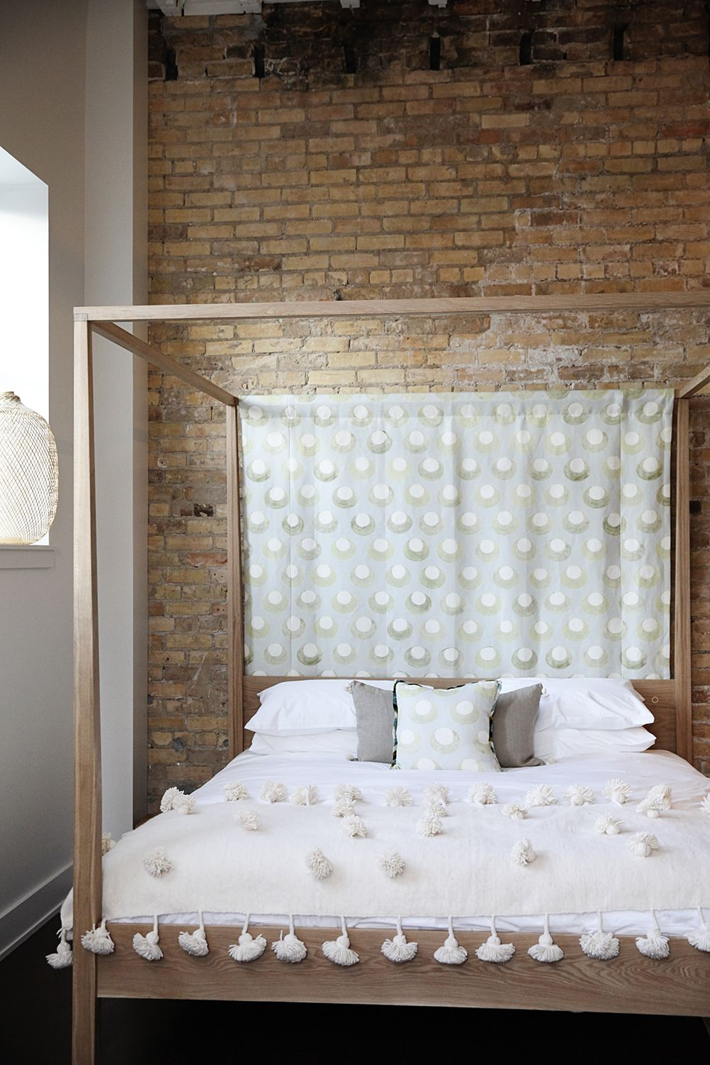 Different headboard cloth adorns each bed.