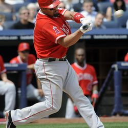 Los Angeles Angels' Albert Pujols hits an RBI-double during the third inning of a baseball game against the New York Yankees Saturday, April 14, 2012 at Yankee Stadium in New York.