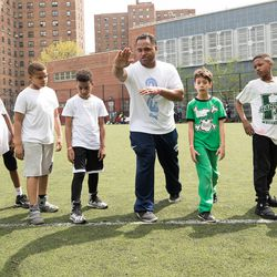 BYU assistant coach Reno Mahe works with youth during a trip to New York City last weekend.