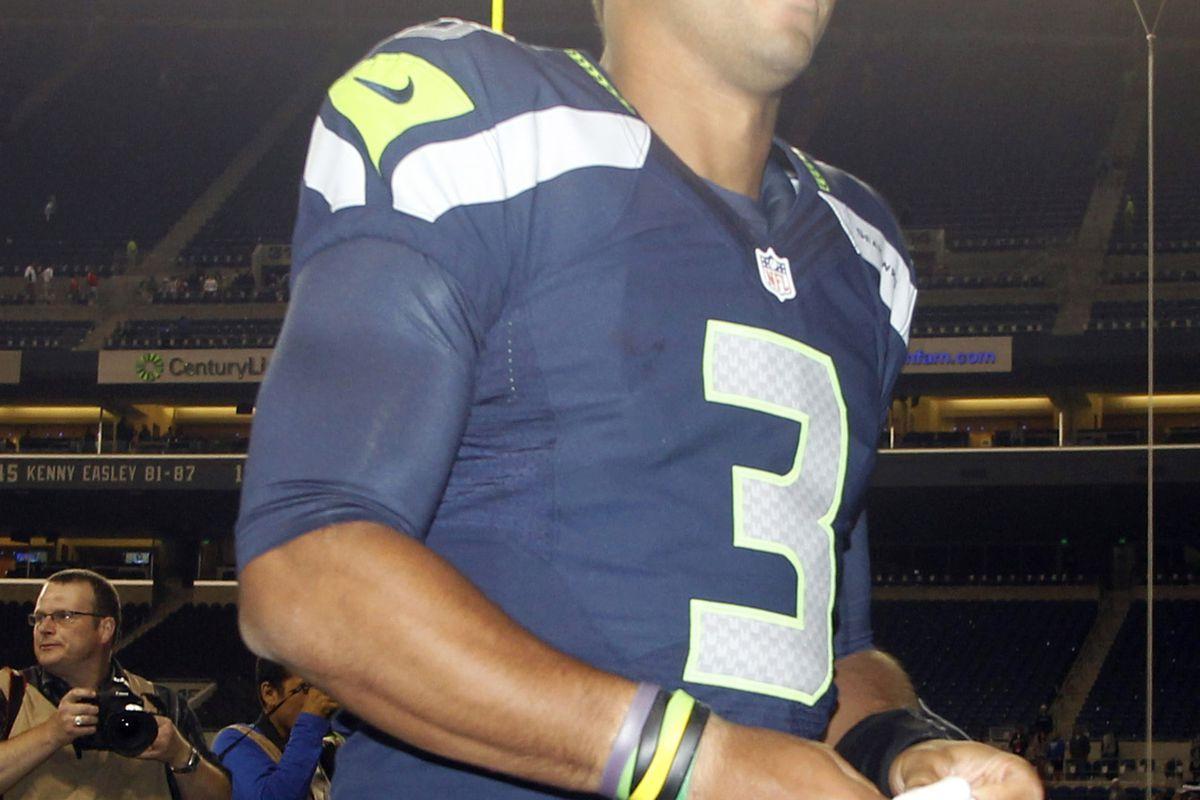 Aug 30, 2012; Seattle, WA, USA; Seattle Seahawks quarterback Russell Wilson (3) returns to the locker room following the Seahawks 21-3 victory over the Oakland Raiders at CenturyLink Field. Mandatory Credit: Joe Nicholson-US PRESSWIRE