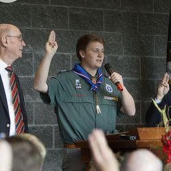 """Caleb Collier, center, leads the audience in """"On My Honor"""" a scout hymn during a dedication ceremony for the Thomas S. Monson Lodge at the Hinckley Scout Ranch in the Uinta Mountains on Wednesday, Oct. 5, 2016. Joining Collier in singing the hymn are Joan Fenton, of the Sorensen Legacy Foundation, left, President Henry B. Eyring, first counselor in the First Presidency of the Church of Jesus Christ of Latter-day Saints, second from left, and Gov. Gary Herbert, right."""