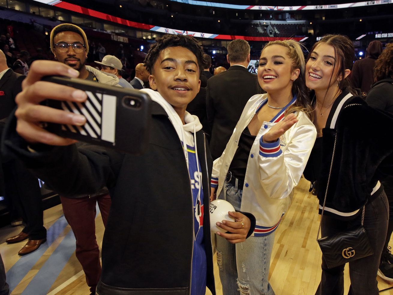 Actor Miles Brown takes a selfie with TikTok stars Addison Rae Easterling and Charlie D'Amelio during the 69th NBA All-Star Game.