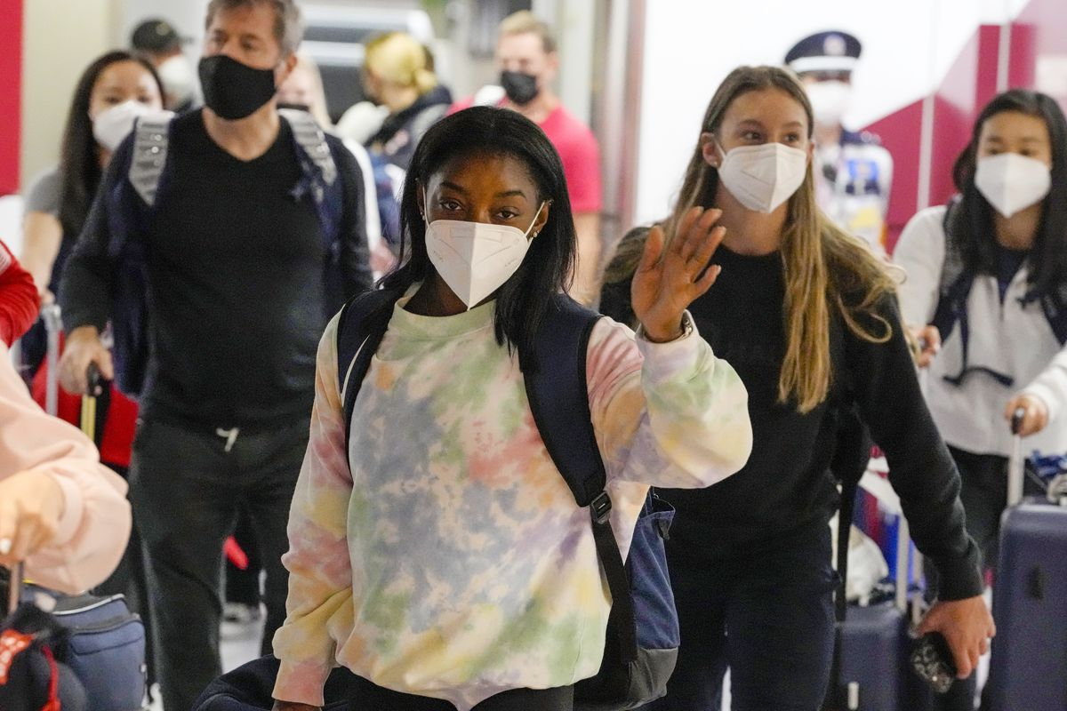 Simone Biles, center, and the U.S. Women's Gymnastics team arrive in Japan for the Tokyo Olympics.