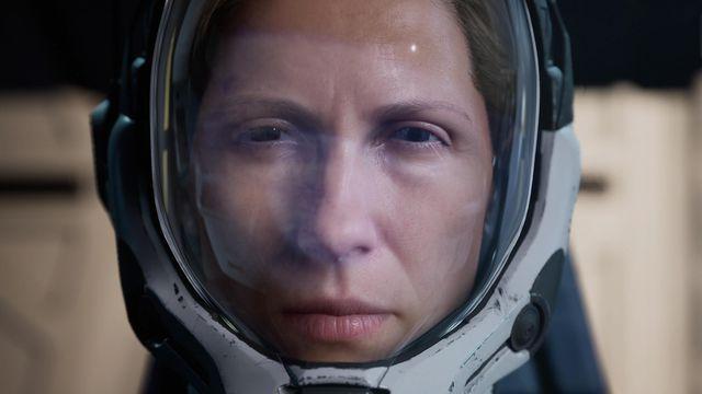 Selene, the main character of Returnal, wearing a space helmet