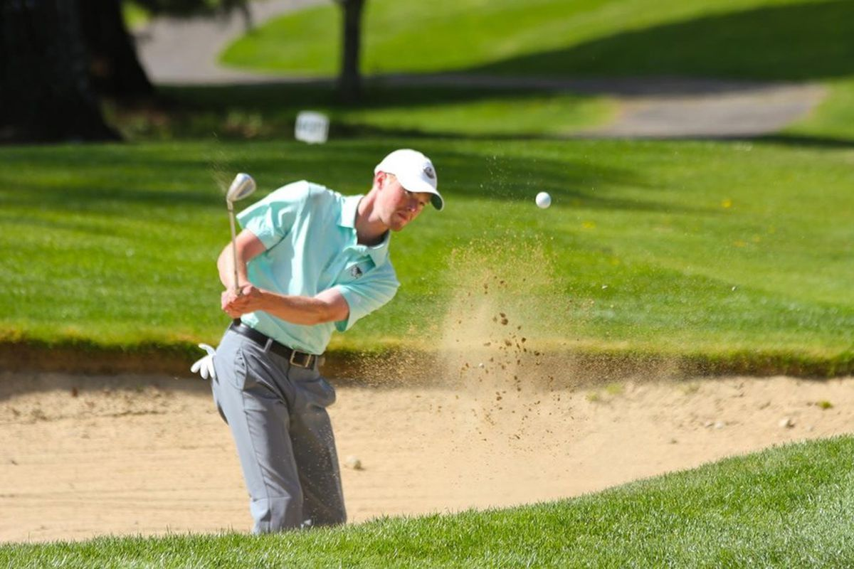 Utah Valley sophomore golfer Jake Bryson hits it out of the sand on Sunday during second round play at the WAC Men's Golf Championship at Oakbrook Golf Club in Lakewood, Wash.