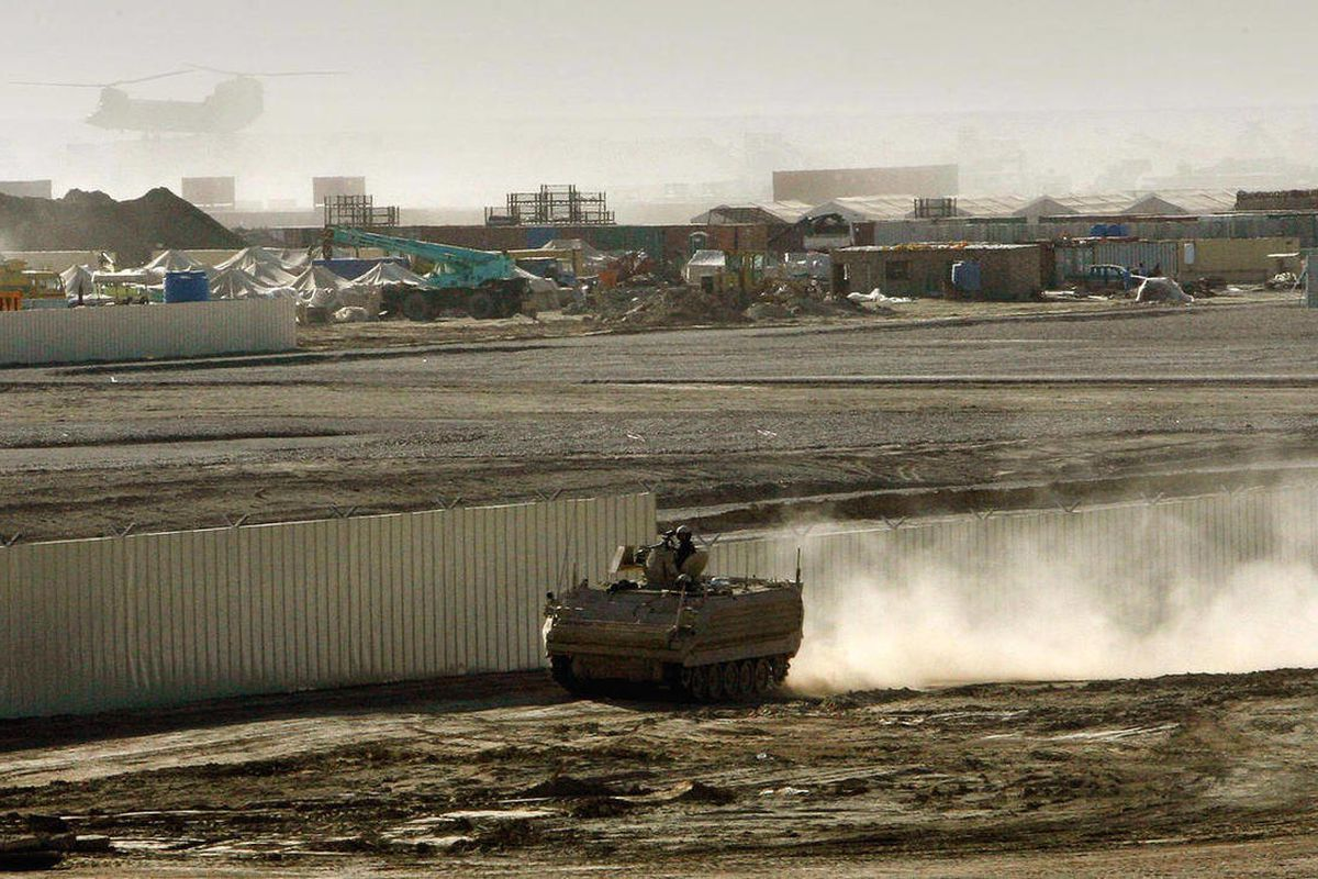 FILE - An armored vehicle patrols on the periphery of Camp Bastion in southern Afghanistan, in this Wednesday, Jan. 10, 2007 file photo. The Taliban claimed responsibility on Saturday, Sept. 15 2012, for an attack against the sprawling British base in sou