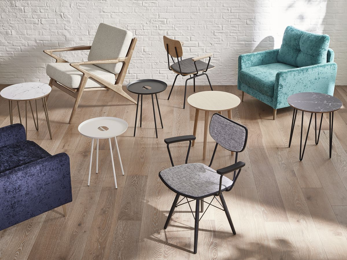 Furniture including armchairs and side tables scattered on timber floor.