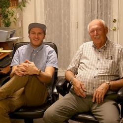 Boman Farrer and his grandfather, Calvin Adams, sit together in Adams' home.