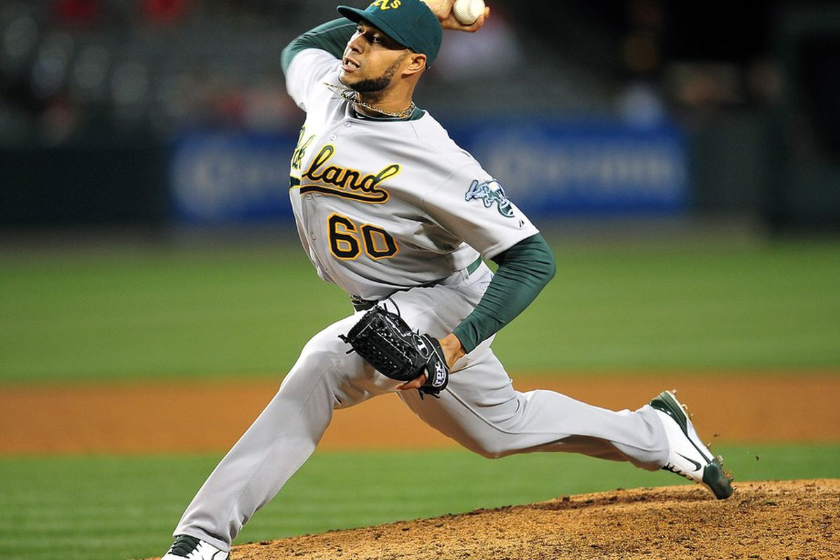 April 18, 2012; Anaheim, CA, USA; Oakland Athletics relief pitcher Fautino De Los Santos (60) pitches in the ninth inning against the Los Angeles Angels at Angel Stadium. Mandatory Credit: Gary A. Vasquez-US PRESSWIRE