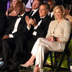 FILE - Five-time heavyweight champion Evander Holyfield, former Massachusetts Gov. Mitt Romney and his wife Ann Romney watch fights before Holyfield and Romney's fight at Charity Vision Fight Night at The Rail Event Center in Salt Lake City on Friday, May 15, 2015.