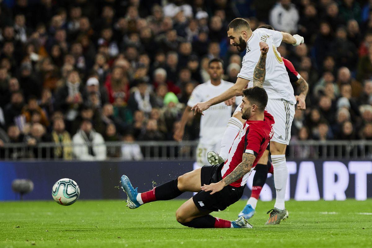 Karim Benzema of Real Madrid and Unai Nunez of Athletic Club...