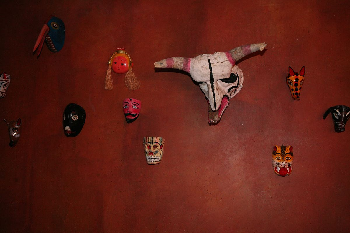 Mexican masks decorate the walls of the downstairs mescal bar at chef Santiago Lastra's new restaurant Kol in Marylebone, central London