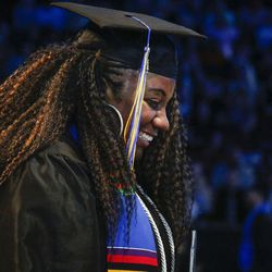 A Salt Lake Community College graduate smiles as she walks off stage after receiving her diploma during the 2017 commencement ceremony at the Maverik Center in West Valley City on Friday, May 5, 2017.