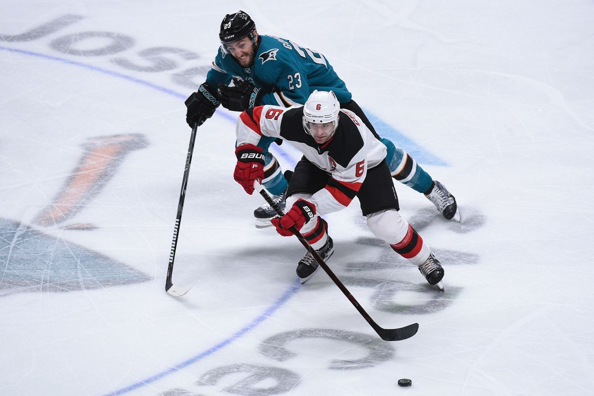 New Jersey Devils Defenceman Andy Greene (6) in action against San Jose Sharks Center Barclay Goodrow (23) during the National Hockey League game between the New Jersey Devils and the San Jose Sharks on December 10, 2018 at the SAP Center in San Jose, CA.