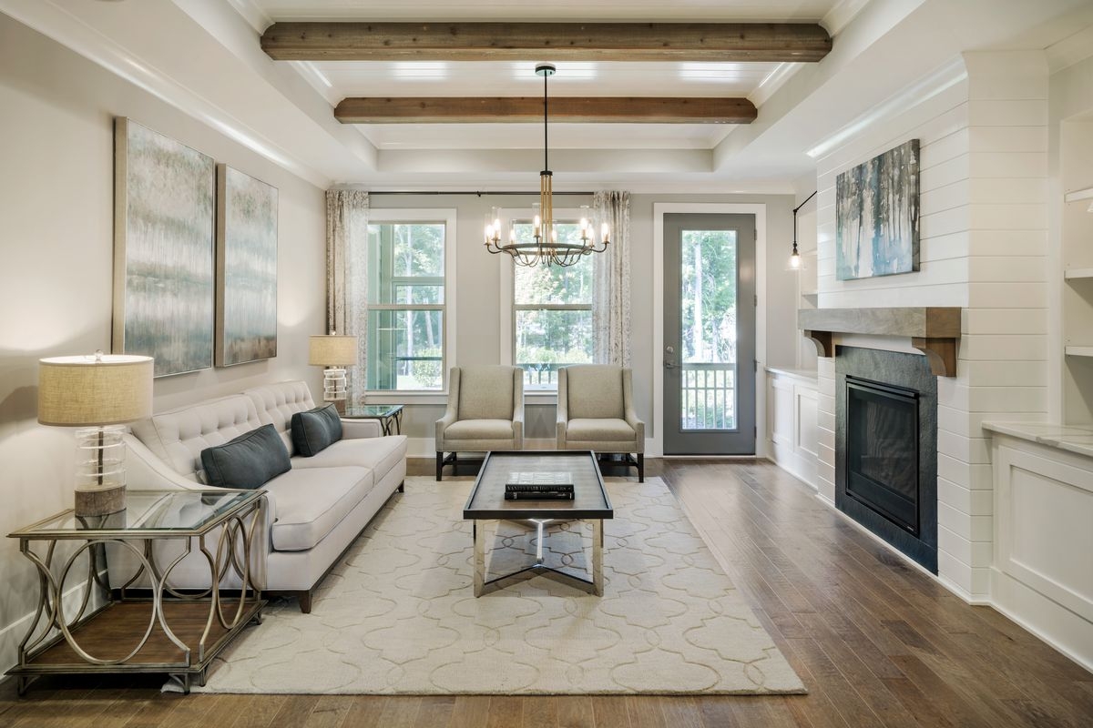 A family room boasts natural wood beams as part of the ceiling in the Ashton Woods GlenPark community in Raleigh, N.C.