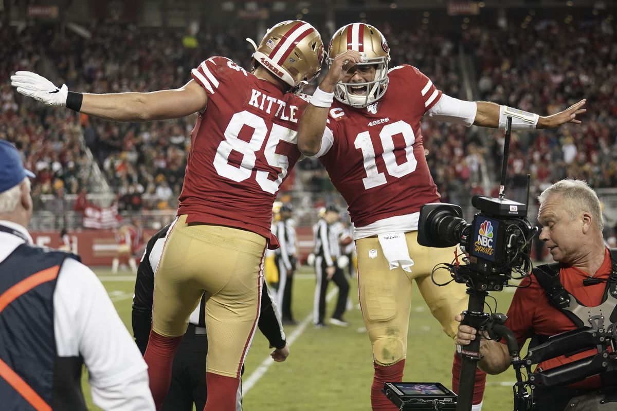 San Francisco 49ers tight end George Kittle and quarterback Jimmy Garoppolo celebrate after scoring a touchdown against the Green Bay Packers during the third quarter at Levi's Stadium.