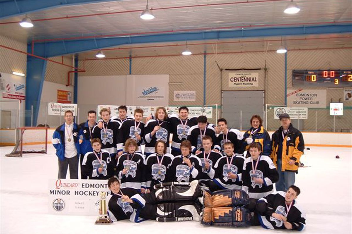 Proof that you can't lose 'em all: After ten years of disappointment, my son's team finally won their Minor Hockey Week division in Midget. He's in the centre of the back row, the rightmost of the big guys. (2004 photo)