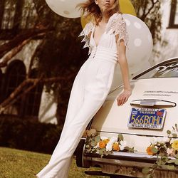 With crochet sleeves and button detailing, this wide leg jumpsuit is great for a bride-to-be with bohemian-leaning taste.