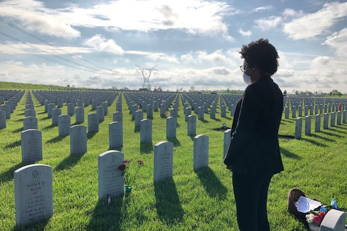 Rep. Lauren Underwood, D-Ill., visits a grave at Abraham Lincoln National Cemetery on Memorial Day.