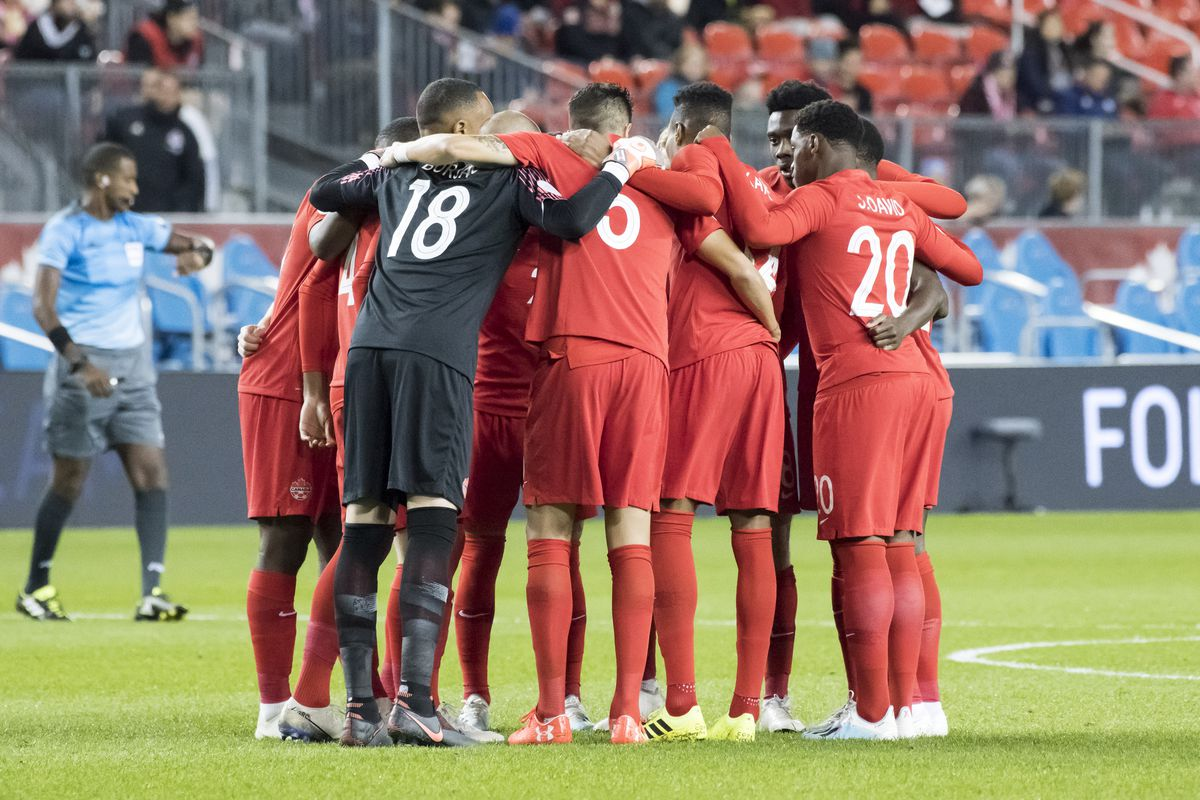 Players of the Canadian National team huddle before the...