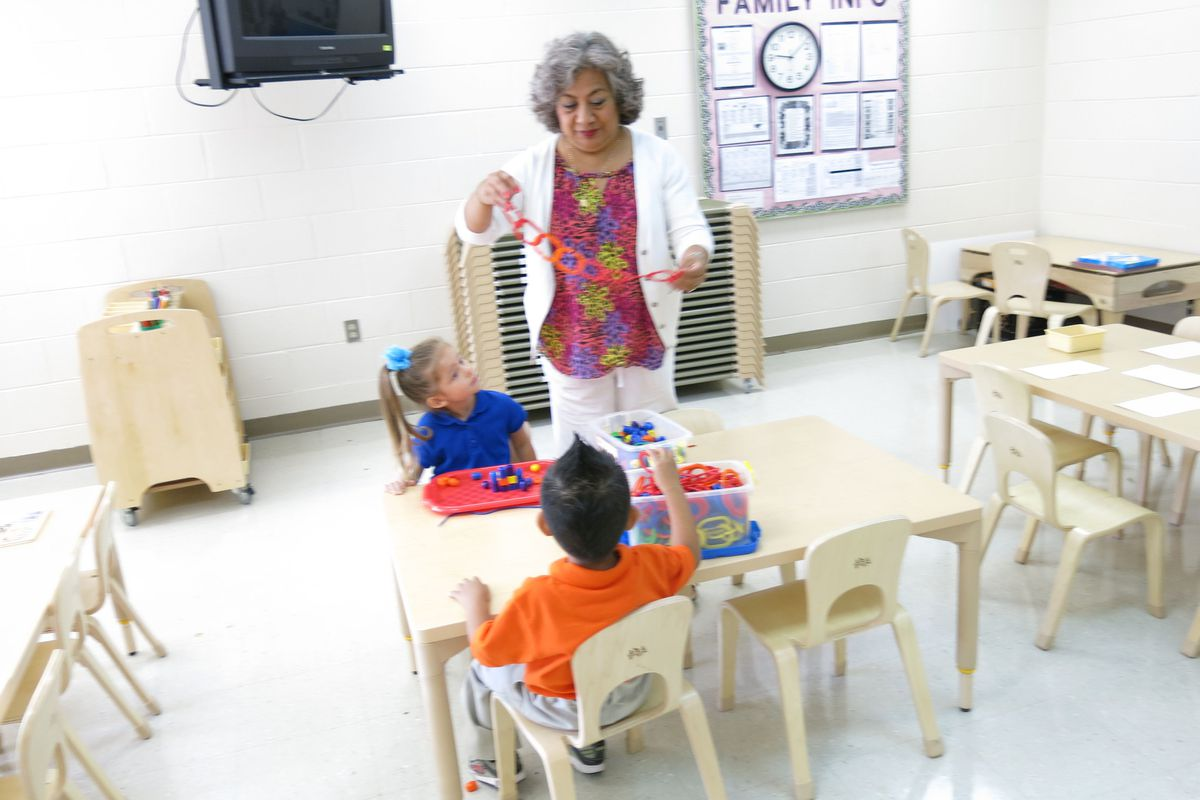 Students in a classroom at Casa Azafran interact with their teacher on the morning of their first-ever day of school.