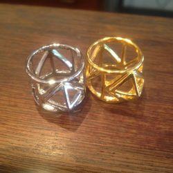 Assad Mounser caged metal rings, $45 each