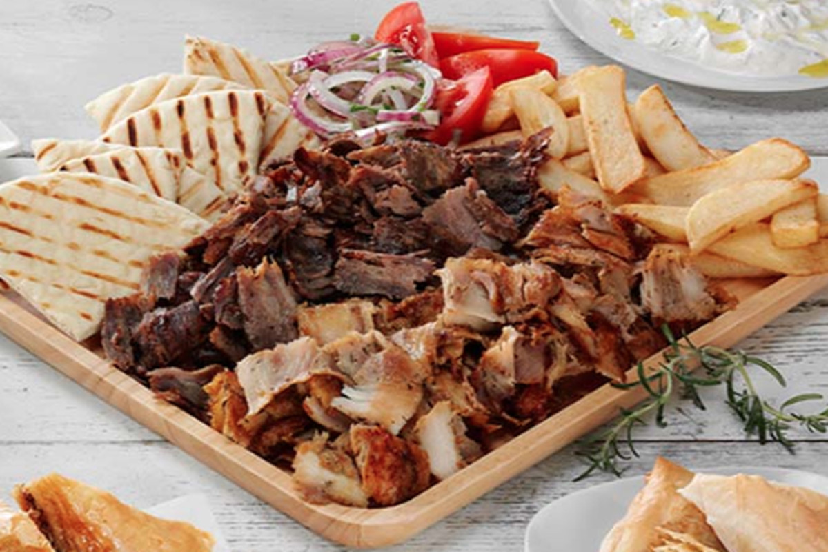 A plate of Mediterranean food by Grecian Delight