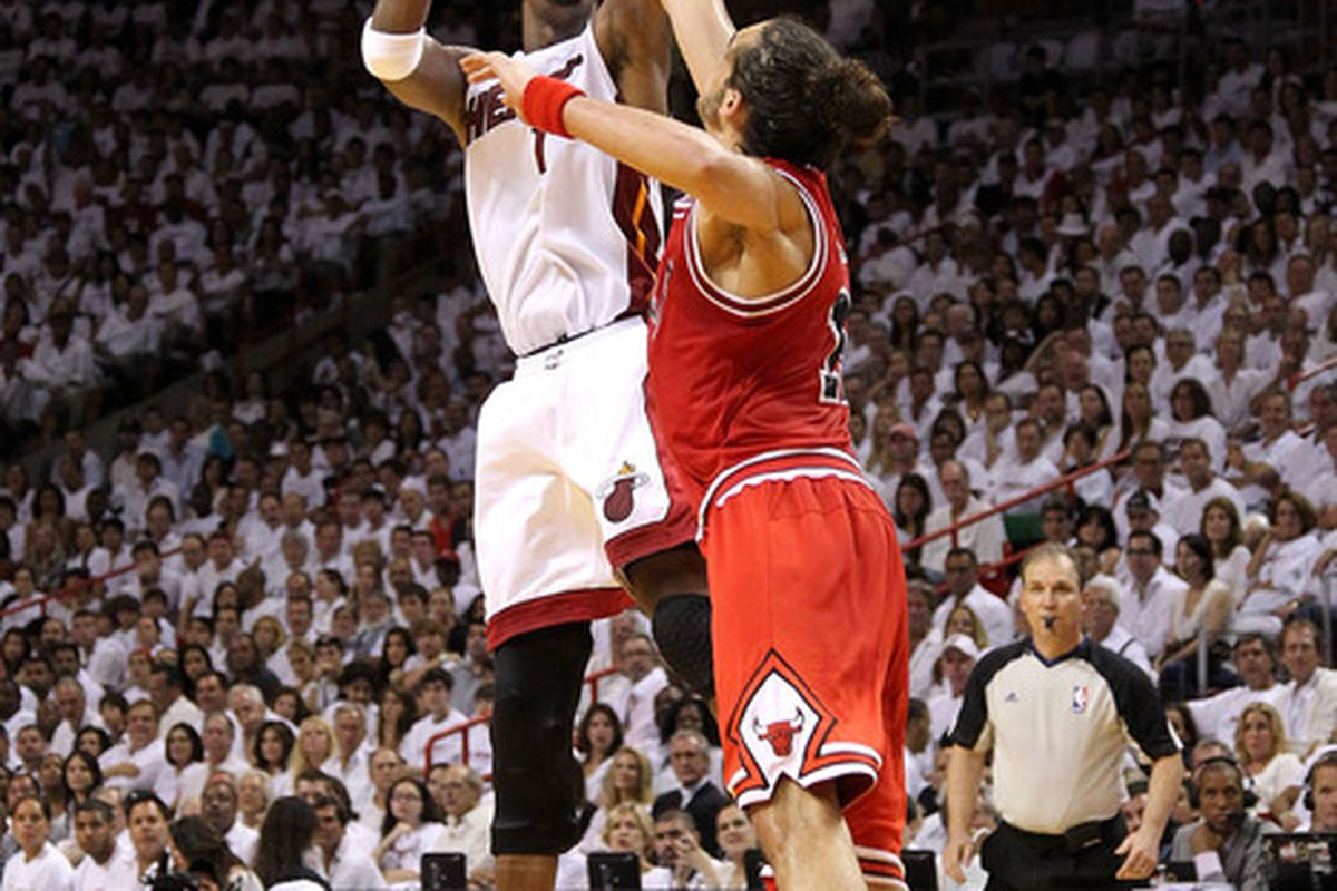 MIAMI, FL - MAY 22:  Chris Bosh attempts a shot agaist Joakim Noah  in Game Three of the Eastern Conference Finals. (Photo by Mike Ehrmann/Getty Images)