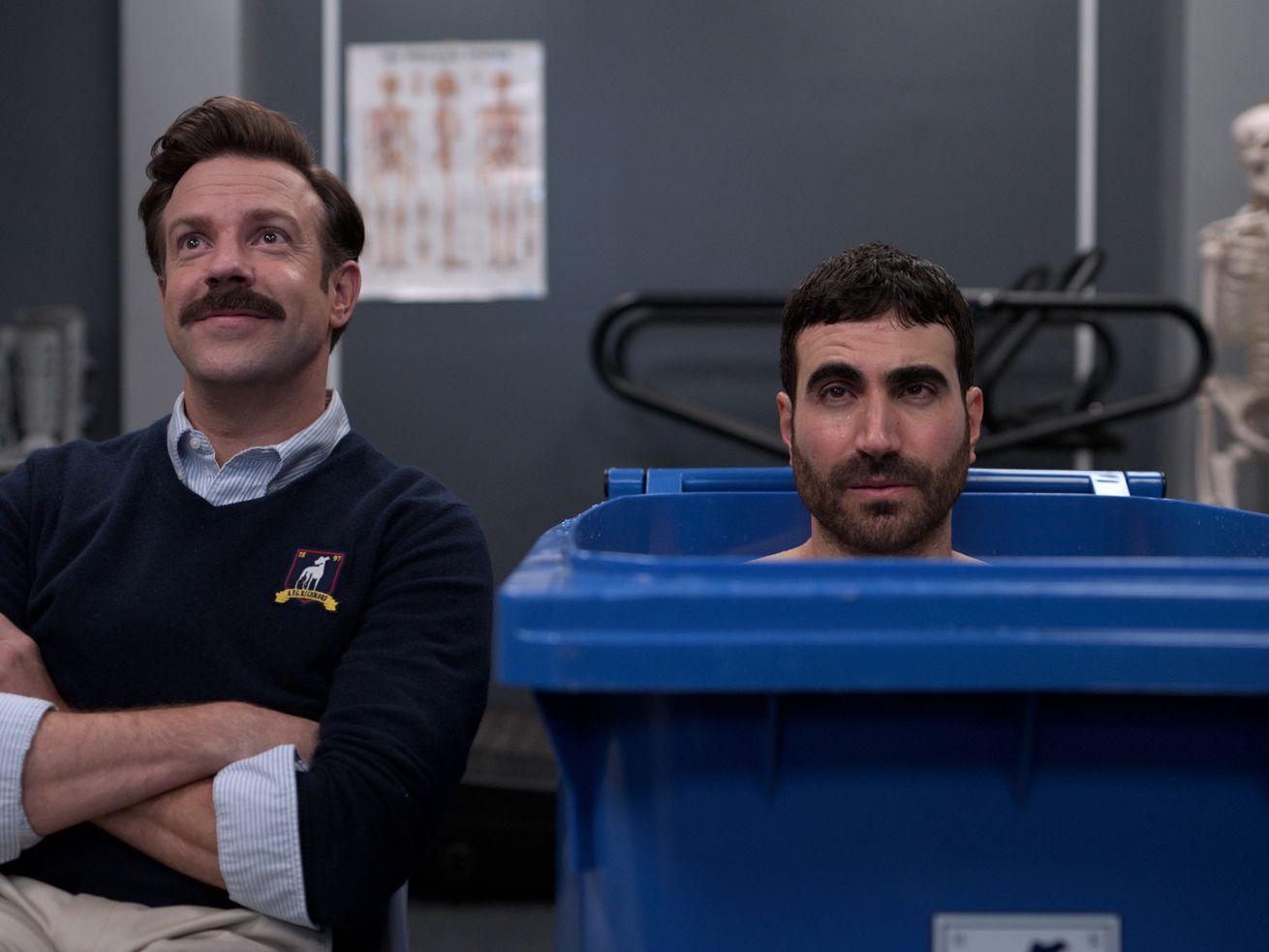 Ted talks to Roy while Roy sits in an ice bath.