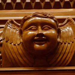 In the renovated baptismal area at Holy Trinity Church in Shanghai, the face of a carved cherub with Chinese features adds a new element.