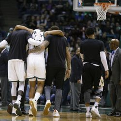 Milwaukee Bucks' Jabari Parker is helped off the court after getting injured in a play against the Miami Heat during the second half of an NBA basketball game Wednesday, Feb. 8, 2017, in Milwaukee. (AP Photo/Jeffrey Phelps)