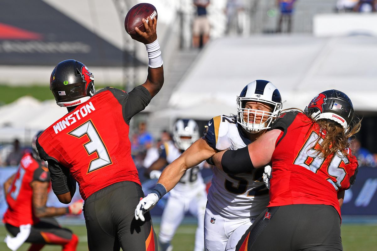 Tampa Bay Buccaneers offensive guard Alex Cappa blocks Los Angeles Rams outside linebacker Clay Matthews as Buccaneers quarterback Jameis Winston throws a pass in the second half at the Los Angeles Memorial Coliseum.