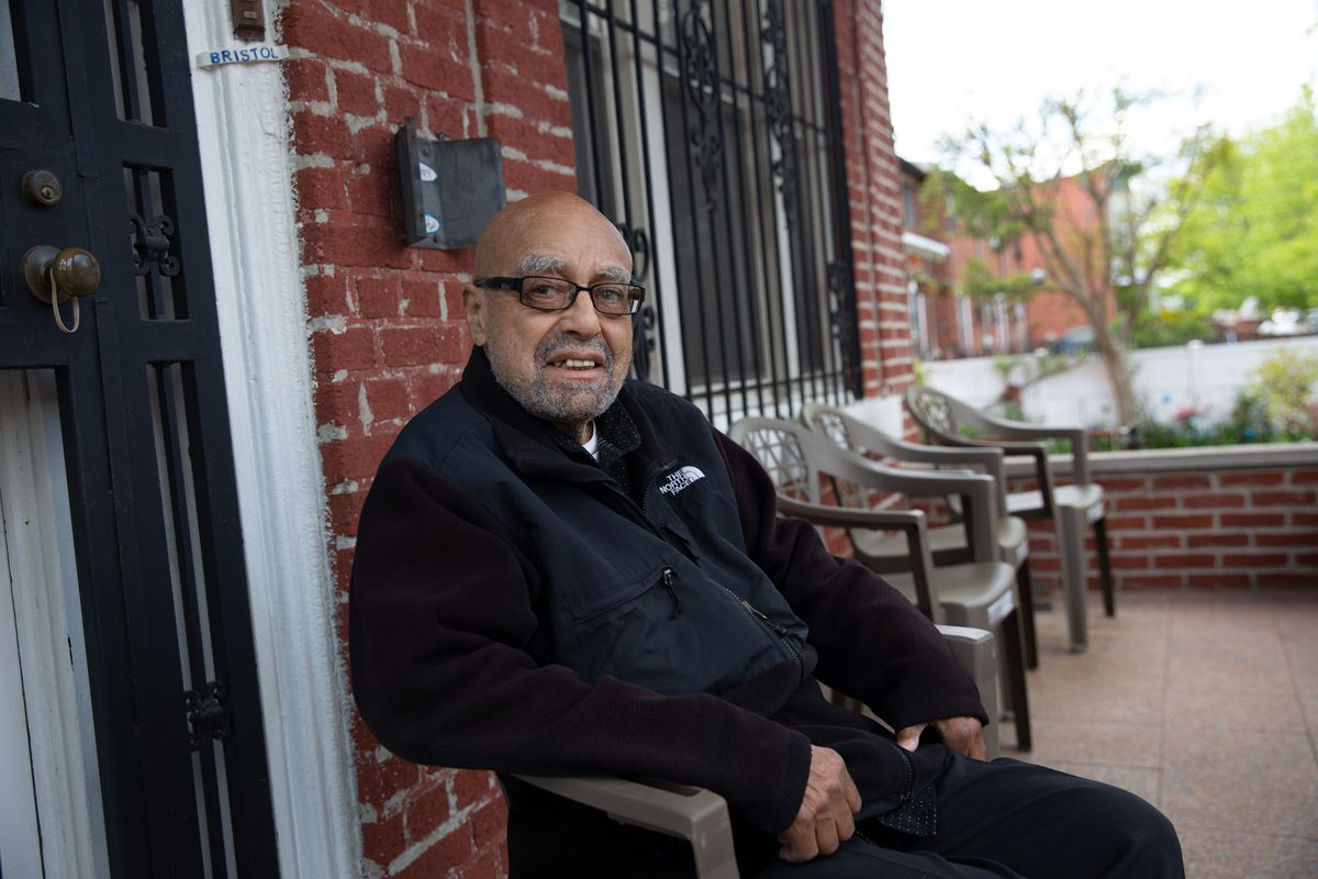 Longtime community activist Carlos Bristol enjoys a nice Spring day on his East New York front porch, May 12, 2021.