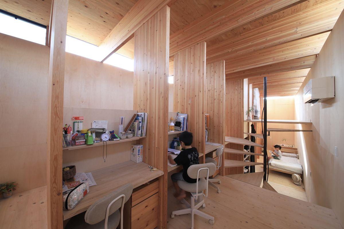 Kid at built-in wooden desk