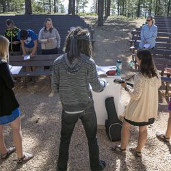 The 9:30 a.m. nondenominational Christian church service sings worship songs in an outdoor amphitheater in Bryce Canyon National Park, Sunday, June 18, 2017.
