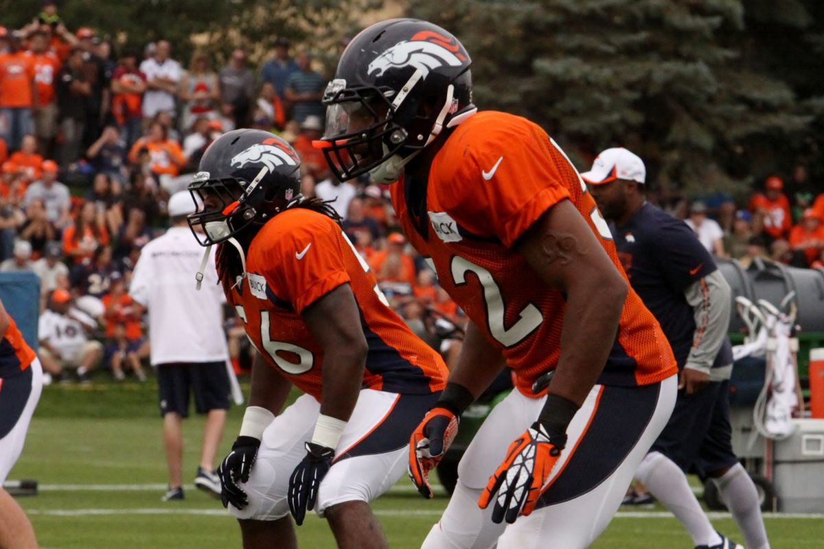 Denver Broncos linebackers Nate Irving and Wesley Woodyard practice at training camp on Sunday, July 28, 2013.