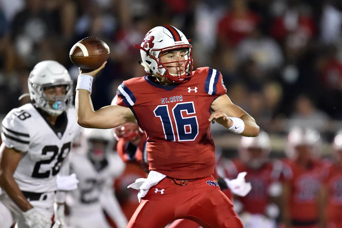 St. Rita's Tommy Ulatowski (16) passes the ball during the game against Mount Carmel.