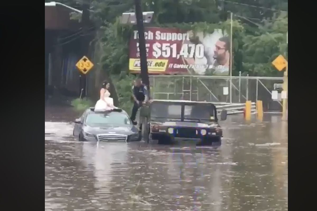 """A New Jersey bride's """"something blue"""" came in the form of a police officer who saved her from a flood."""