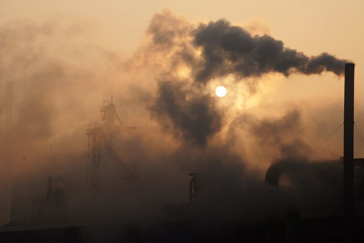 A cement factory releasing heavy smoke in eastern China