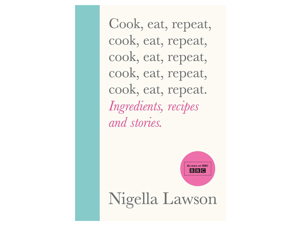 The front cover of Nigella Lawson's new cookbook, Cook Eat Repeat, with a blue spine and grey and pink text