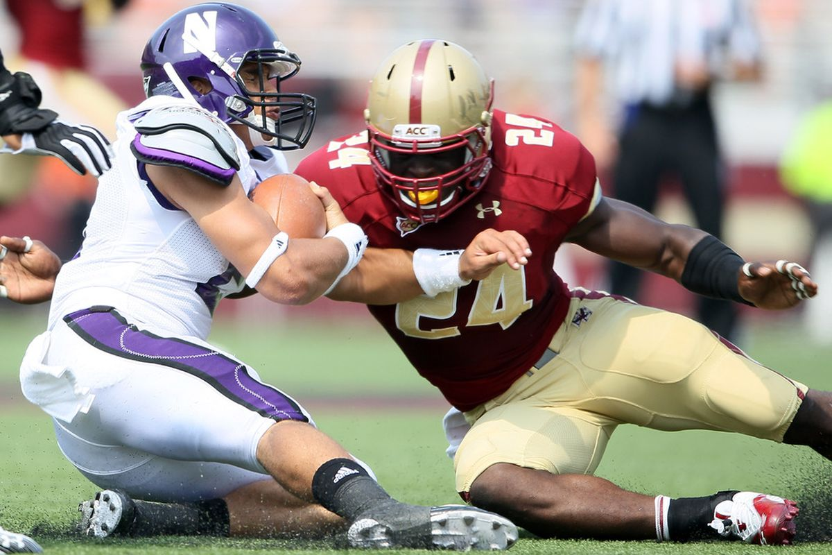 CHESTNUT HILL, MA - SEPTEMBER 03:  Kain Colter #2 of the Northwestern Wildcats is tackled by Kevin Pierre-Louis #24 of the Boston College Eagles on September 3, 2011 at Alumni Stadium in Chestnut Hill, Massachusetts.  (Photo by Elsa/Getty Images)