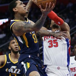 Utah Jazz guard Jordan Clarkson (00) goes to the basket against Detroit Pistons forward Christian Wood (35) during the second half of an NBA basketball game Saturday, March 7, 2020, in Detroit.