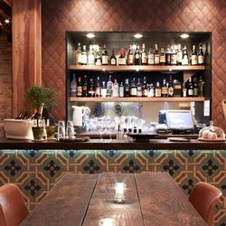 Beautiful tile fronts the upstairs bar