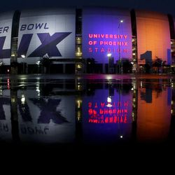 The Super Bowl XLIX is displayed on the University of Phoenix Stadium Thursday, Jan. 29, 2015, in Glendale, Ariz. The New England Patriots face the Seattle Seahawks in Super Bowl XLIX on Sunday. (AP Photo/Charlie Riedel)