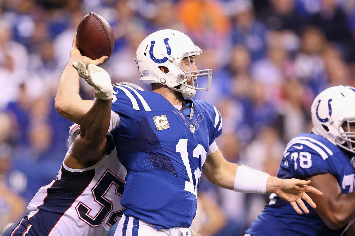 INDIANAPOLIS, IN - Indianapolis Colts quarterback Andrew Luck (12) is hit as he throws by New England Patriots linebacker Dont'a Hightower (54) at Lucas Oil Stadium.