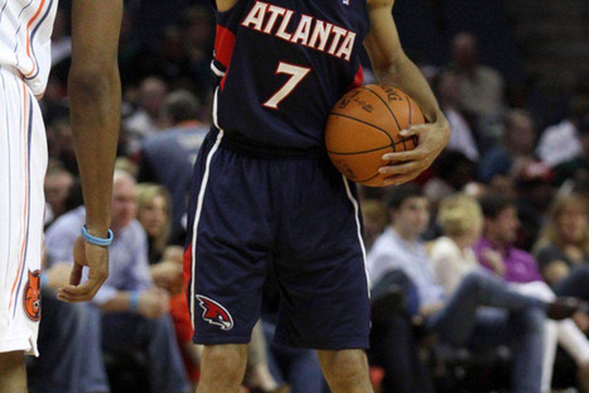 Apr 7, 2012; Charlotte, NC, USA Atlanta Hawks point guard Jannero Pargo (7) sets up a play during the first half against the Charlotte Bobcats at Time Warner Cable Arena. Mandatory Credit: Jeremy Brevard-US PRESSWIRE