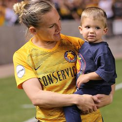 Utah Royals FC forward Amy Rodriguez (8) holds and talks to her son Luke after a match against the Orlando Pride at Rio Tinto Stadium in Sandy on Wednesday, May 9, 2018.